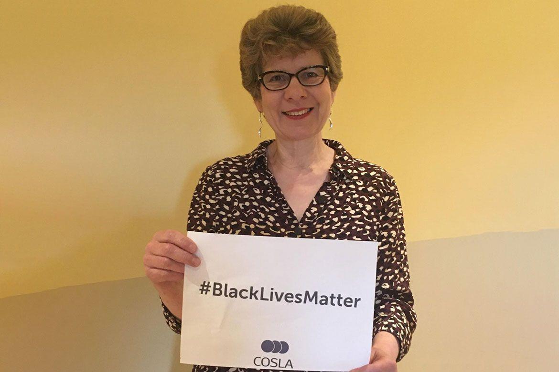 Councillor Alison Evison holds Black Lives Matter sign